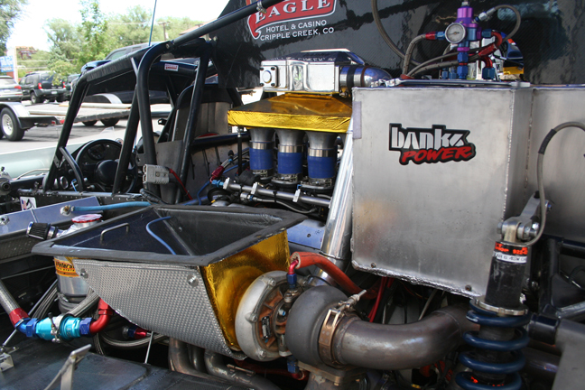 A closer look at one of the Banks Sidewinder turbos as well as the Banks Twin-Turbo intake plenum (seen above the velocity stacks) with the bodywork removed from the Dallenbach-Banks racecar.
