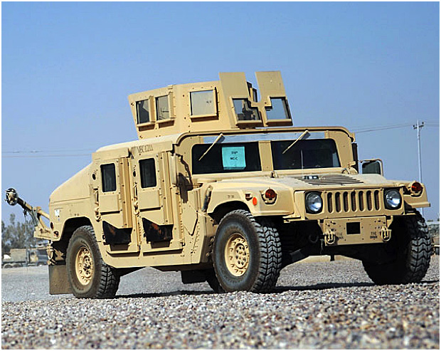 An Up-Armored Humvee with gun turret