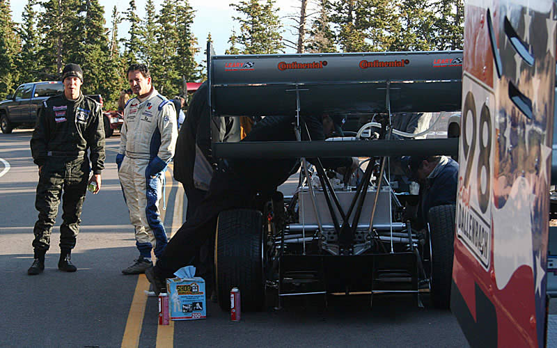 Paul and Wyatt Dallenbach discuss how their cars are working and team strategy before they get going with their test runs on the middle section of the course.