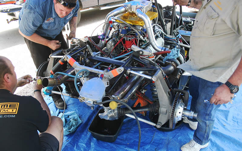 Just accessing the rear-mounted transaxle in the mid-engine car is difficult, much less doing it in a campground. But we can see more of that amazing engine in this shot with all the rear wings and body panels removed.